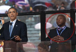 B Obama & interpreter