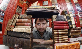 Lazik surrounded by books